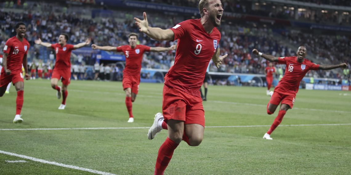 England's Harry Kane (C) celebrates after scoring against Tunisia at the Volgograd Arena in Volgograd, Russia