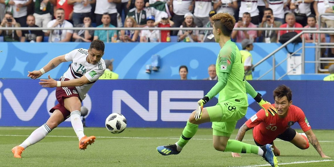 Mexico's Javier Hernandez shoots to score the second goal for his side against South Korea, Saturday