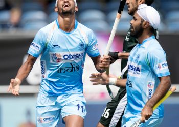 Mandeep Singh of India celebrates after scoring the third goal for India against Pakistan in the Champions Trophy encounter, Saturday