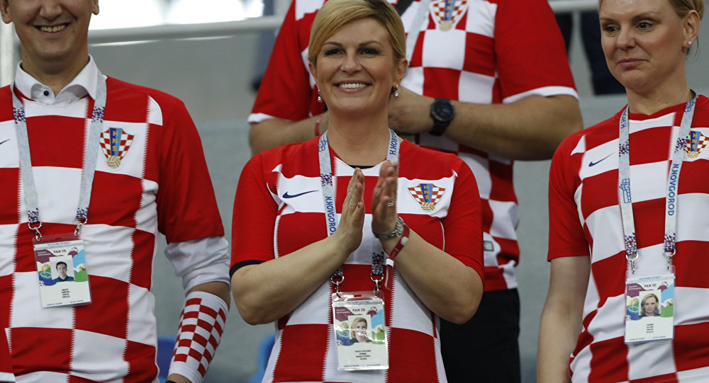 Croatian leader hands Putin soccer shirt before World Cup final