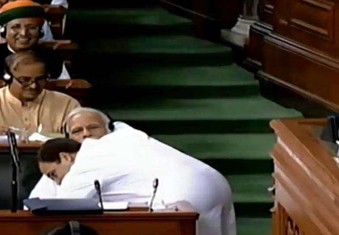 Indian opposition leader Gandhi startles bitter foe Modi with a hug