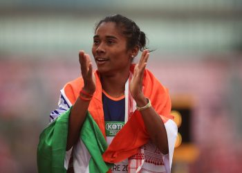 Hima Das of India celebrates winning gold in the final of the women's 400m in IAAF World U-20 Championships