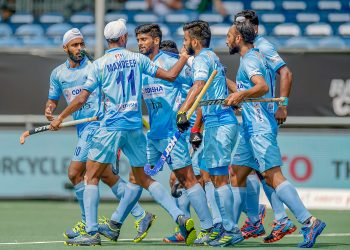 Indian players celebrate after scoring their first goal against Australia in the final at Breda, Sunday