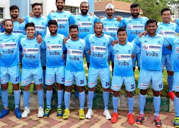 Indian hockey team players selected Monday for the Asian Games pose in New Delhi