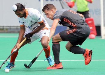 Mandeep Mor (L) the man who scored both the goals for India, trying to get past a Dutch player, Saturday