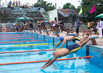 Swimmers in action during the State Police Swimming Championship at Cuttack, Monday