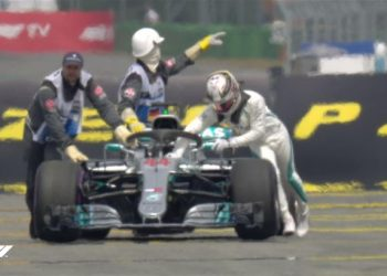 Lewis Hamilton pushes his car out of German qualifying