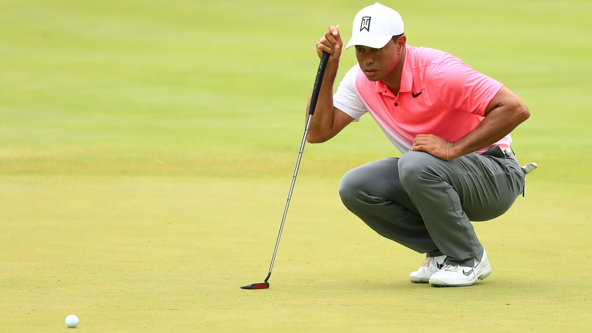 Molinari finishes with a flourish, as Woods falters
