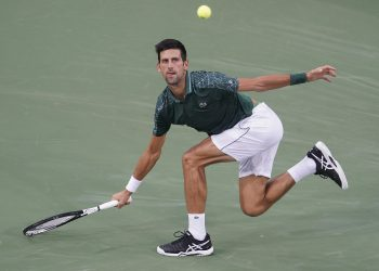 Novak Djokovic runs down a shot from Grigor Dimitrov at the Cincinnati Masters tennis tournament