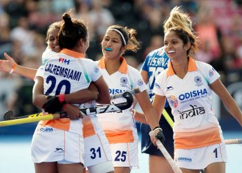 Lalremsiami (C) celebrates with teammate Lilima Minz after scoring India's first goal against Italy, Tuesday