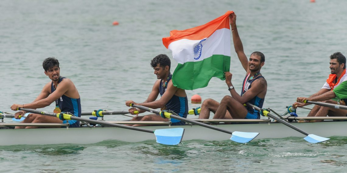 Rowers Sawarn Singh, Dattu Baban Bhokanal, Om Prakash and Sukhmeet Singh pose with after winning gold, Friday