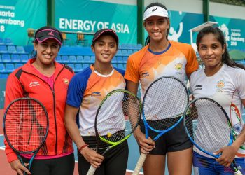 Indian women's tennis team members Ankita Raina, Karman Kaur and Prarthna with their coach Ankita Bhambri (L) pose for a photo after a practice session, Friday