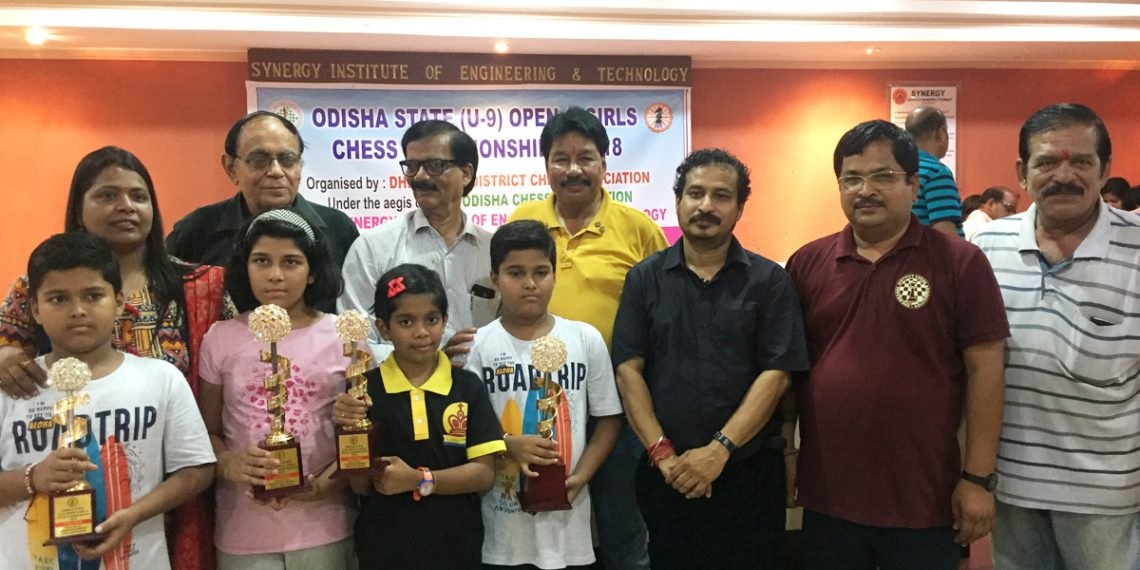Winners in various categories of All Odisha U-9 chess Championship pose with their winners' trophies along with guests in Dhenkanal, Sunday