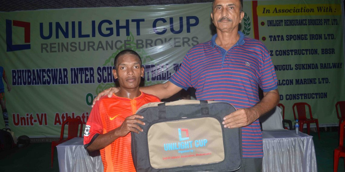 Kunaram Soren of KISS receives the man of the match prize in Bhubaneswar, Friday