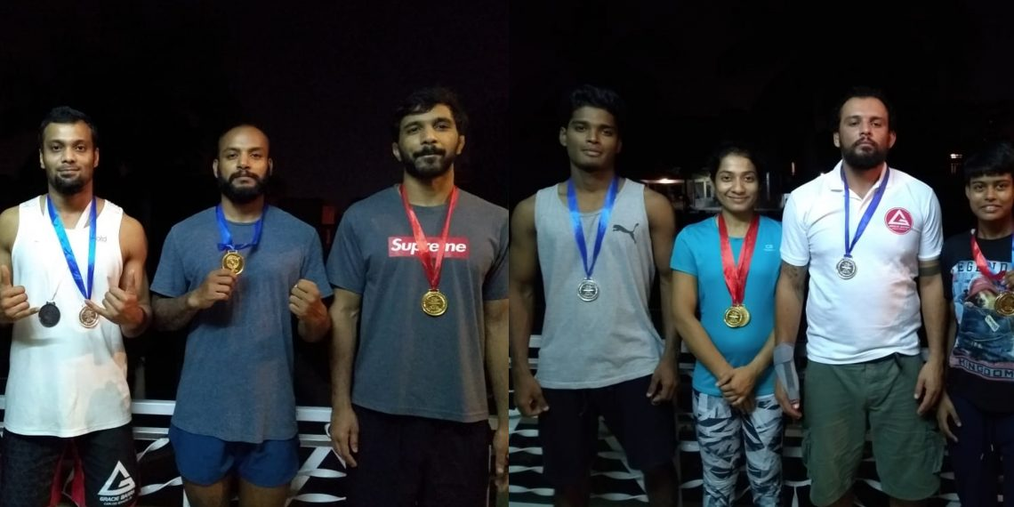 Odisha grapplers pose with their medals at Rohtak, Wednesday