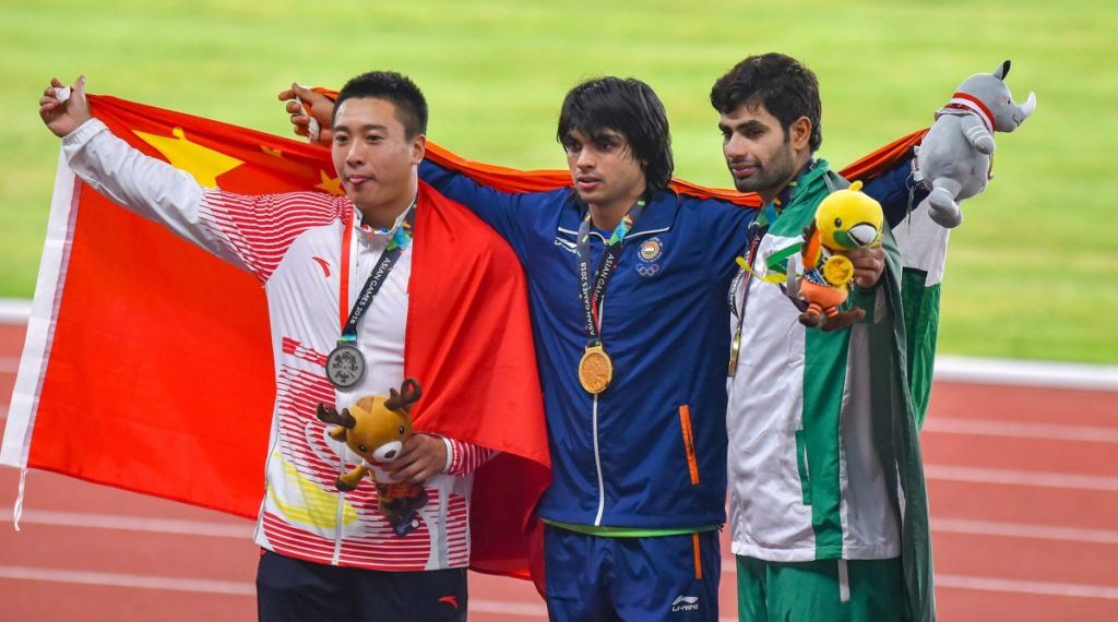 Pakistan's Arshad Nadeem (R) shares the podium Neeraj Chopra of India (C) and Liu Qizhen of China during the medal ceremony at the Asian Games