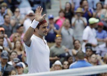 Roger Federer waves to the crowd after his second round win Thursday over Benoit Paire