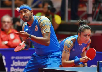 A Sharath and Manika Batra in action during the mixed-double table tennis match in Jakarta, Wednesday