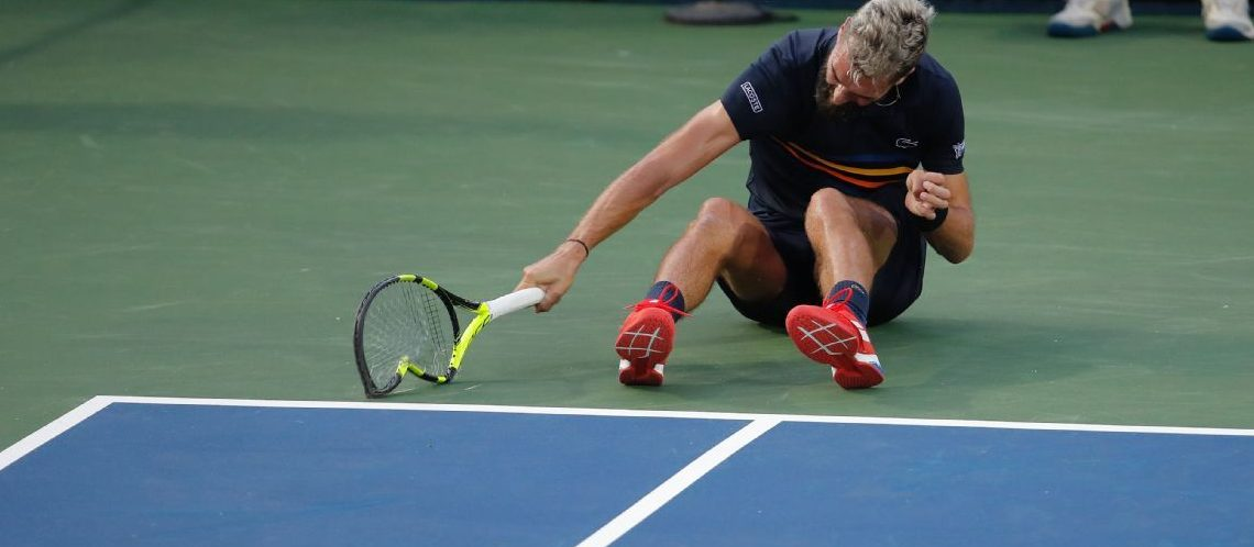 Benot Paire hurls his racqet on the court after losing to Marcos Baghdatis at the Washington Open