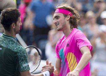 Novak Djokovic (L) congratulates Stefanos Tsitsipas after the latter's stunning win, Thursday at Toronto