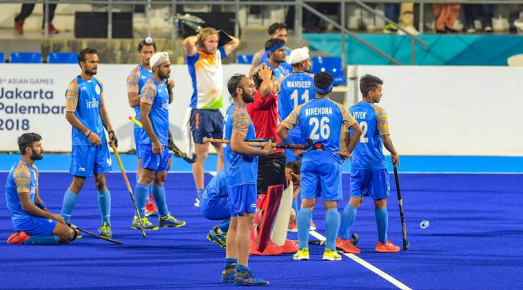 Indian hockey team look on after being defeated by Malaysian in the semifinal match of Asian Games