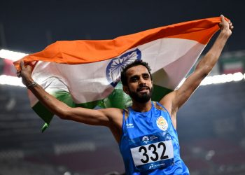 Manjit Singh of India celebrates victory after winning Men's 800m at the Asian Games
