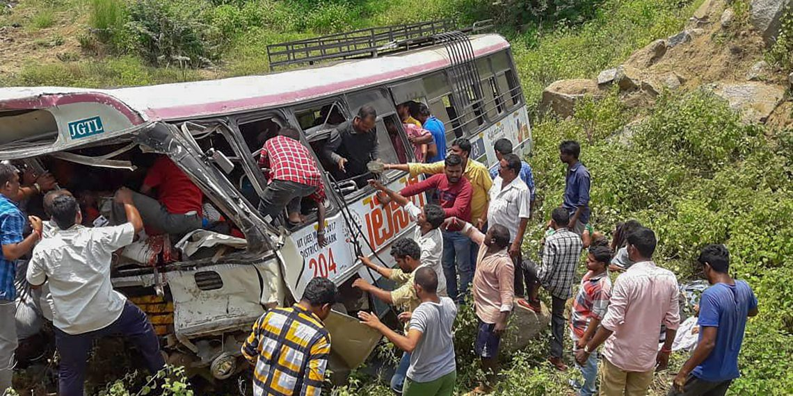 Rescue officials at the accident site where a state-owned Road Transport Corporation bus skidded into a deep gorge, at Jagtial district, Tuesday