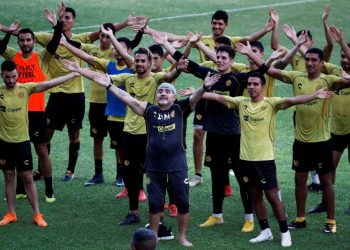 Diego Maradona sings with the Dorados players and fans (not in picture) on his first practice session with the team