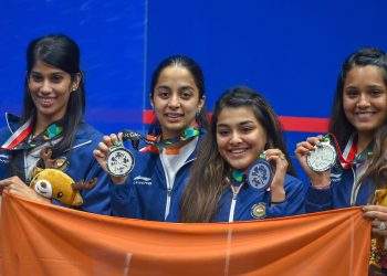 India's women squash team (L-R) Joshana Chinappa, Tanvi Khanna, Sunayna Kuruvilla and Dipika Pallikal Karthik pose with their silver medal after the presentation ceremony