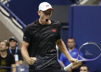 John Millman reacts after winning a point against Roger Federer during their fourth round match of the US Open