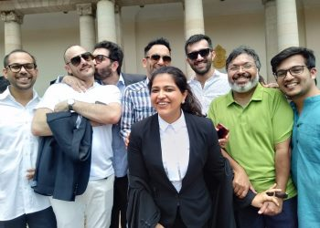 Keshav Suri, one of the petitioners and executive director of Lalit Group of Hotels, kisses his French partner Cyril Feuillebois, following the judgement in New Delhi, Thursday. Also seen among others are writer Devdutt Pattanaik (in green shirt) and advocate Neha Nagpal