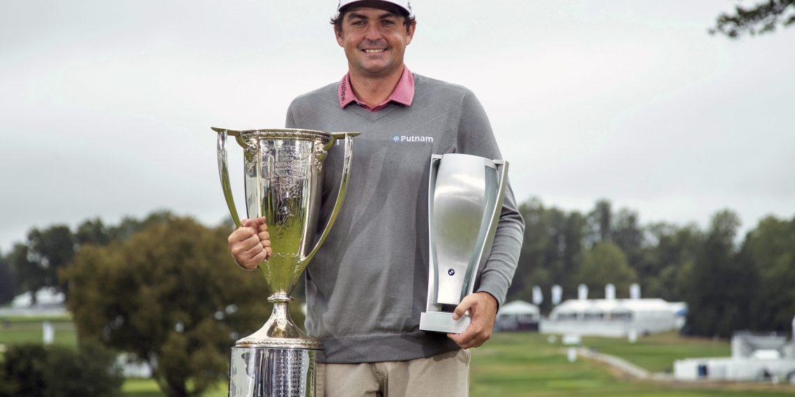 Keegan Bradley poses with the two trophies following the BMW Championship golf tournament at the Aronimink Golf Club