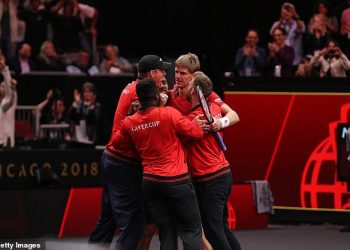Team World players hug Kevin Anderson (right) after his stunning win over Novak Djokovic at Chicago, Saturday