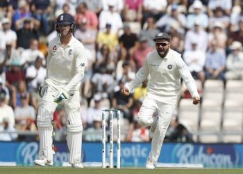 Virat Kohli (R) celebrates after England's Keaton Jennings was given out lbw off the bowling of Mohammed Shami during play on the third day of the 4th Test match