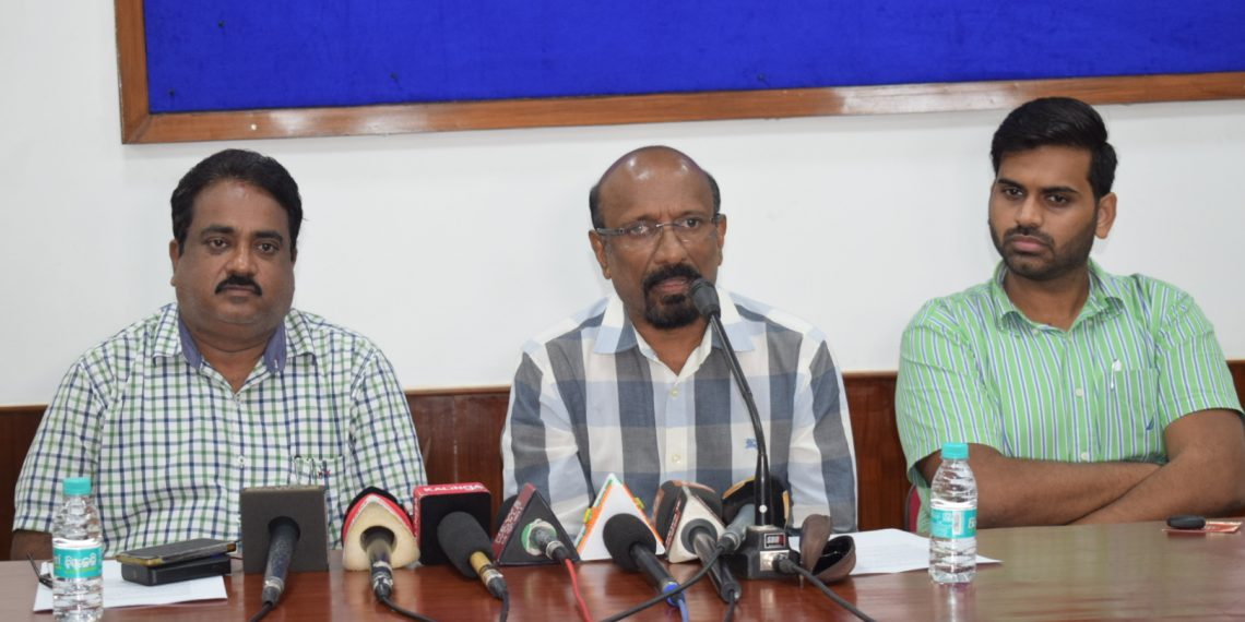 AFI general secretary CK Valson (C) along with state sports department officials Manoj Padhi (L) and Sumit Pandey address the media at the Kalinga Stadium conference hall, Tuesday
