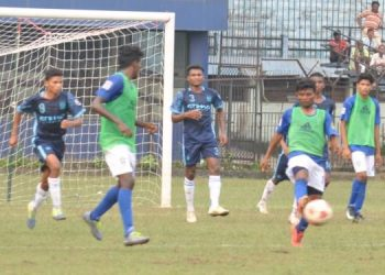 Sunshine Club and Azad Hind Club players vie for the ball during their match at Cuttack, Monday