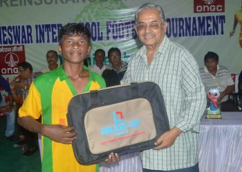 Sundar Mohan Kisko of Unit-I High School receives the man of the match award in Bhubaneswar, Thursday