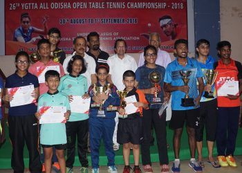 Winners in different categories of the YGTTA All Odisha Open Table Tennis Championships pose with their trophies and certificates along with guests at Cuttack, Saturday
