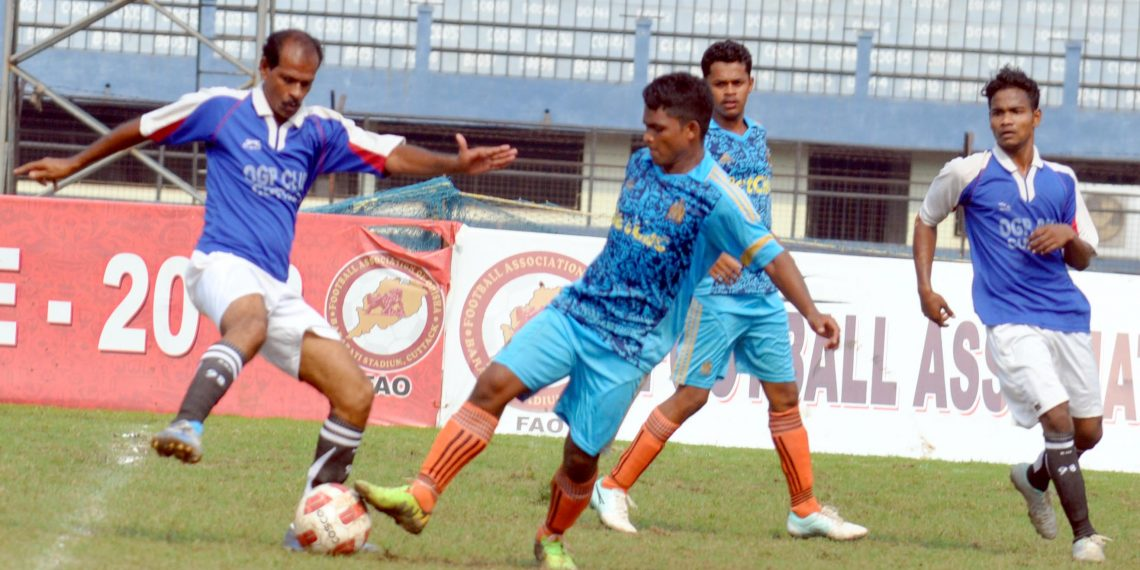OGP and Town Club players in action during their match at Barabati Stadium in Cuttack, Tuesday