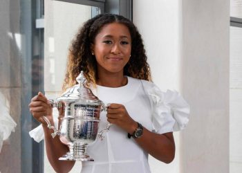 Naomi Osaka shows off the US Open women's singles trophy Sunday at the Rockefeller Centre in New York