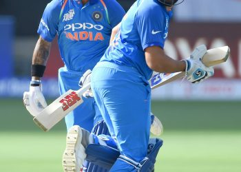 In-form Indian openers Shikhar Dhawan (L) and skipper Rohit Sharma are expected to provide their side a good start against Pakistan, Sunday