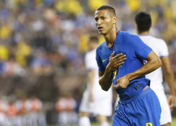 Brazil's Richarlison celebrates after scoring against El Salvador, Tuesday