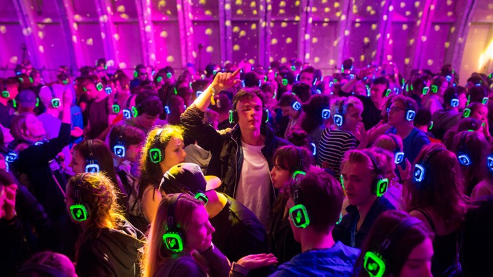 Festival goers dance at the silent disco stage during Open'er music Festival in Gdynia, Poland June 28, 2017. Picture taken June 28, 2017. REUTERS/Matej Leskovsek - RC1F38A7CBC0