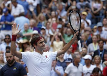 Roger Federer reacts after defeating Nick Kyrgios during the third round of the US Open tennis tournament