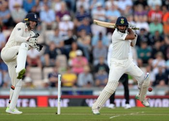 Cheteshwar Pujara plays a shot against England