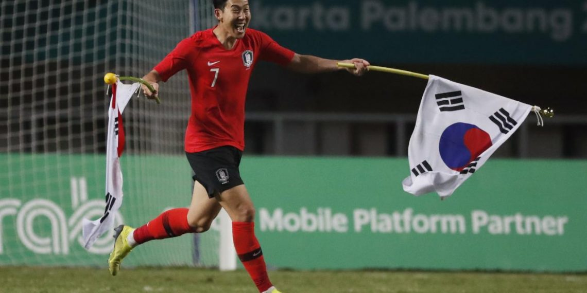 Son Heung Min of South Korea celebrates after winning the gold medal match against Japan at Asian Games