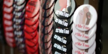 A vendor sells #MeToo badges a protest march for survivors of sexual assault and their supporters in Hollywood, Los Angeles, California U.S. November 12, 2017. REUTERS/Lucy Nicholson - RC18A2D7F850