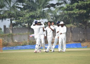 Shivam Mavi (C) celebrates with UP teammates after dismissing an Odisha batsman, Wednesday