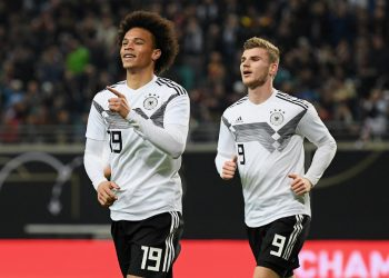 Leroy Sane celebrates Germany's opening goal as Timo Werner (R) runs to join in against Russia, Thursday