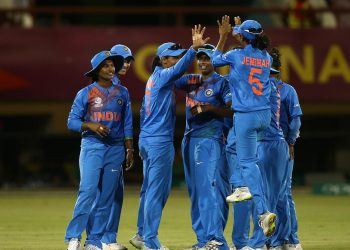 Indian players celebrate after dismissing an England batswoman during their second warm-up match, Wednesday